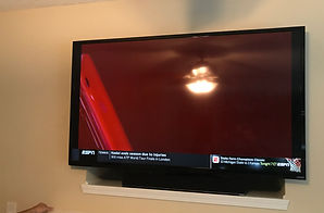 "70"" TV over fieplace in Greensboro, NC 27455"