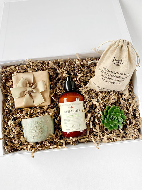 Spa gift box for her with a soy candle, hand lotion, chocolate truffles, lavender bath bomb and a succulent plant