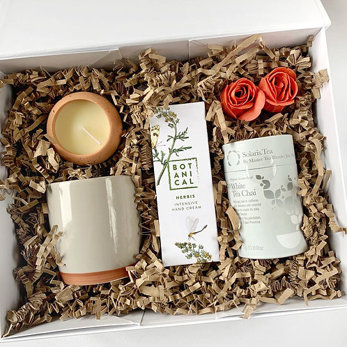 White gift box for her with Solaris White Chai Tea, botanical handcream, ceramic mug and a terracota tea light for delivery
