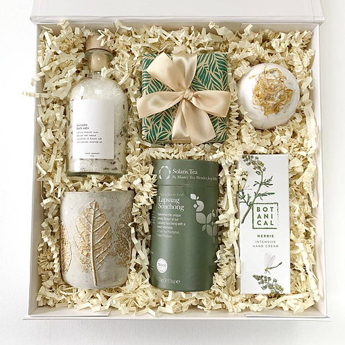 Luxury hamper for her with organic black tea, hand poured candle, chocolate truffle box, bath bomb with petal flowers