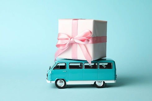 toy-bus-with-gift-box-blue-background (1).jpg