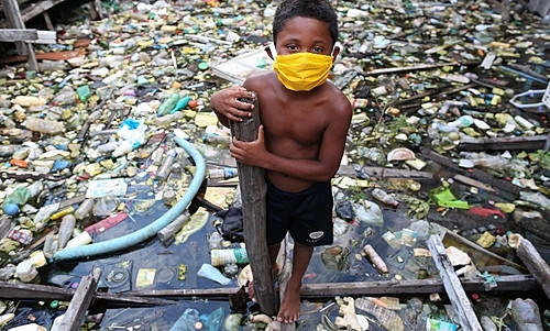 Boy from the riverside community of Educandos wears a face mask during a coronavirus pandemic in Manaus (AM).