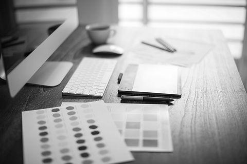 Desk full of design tools