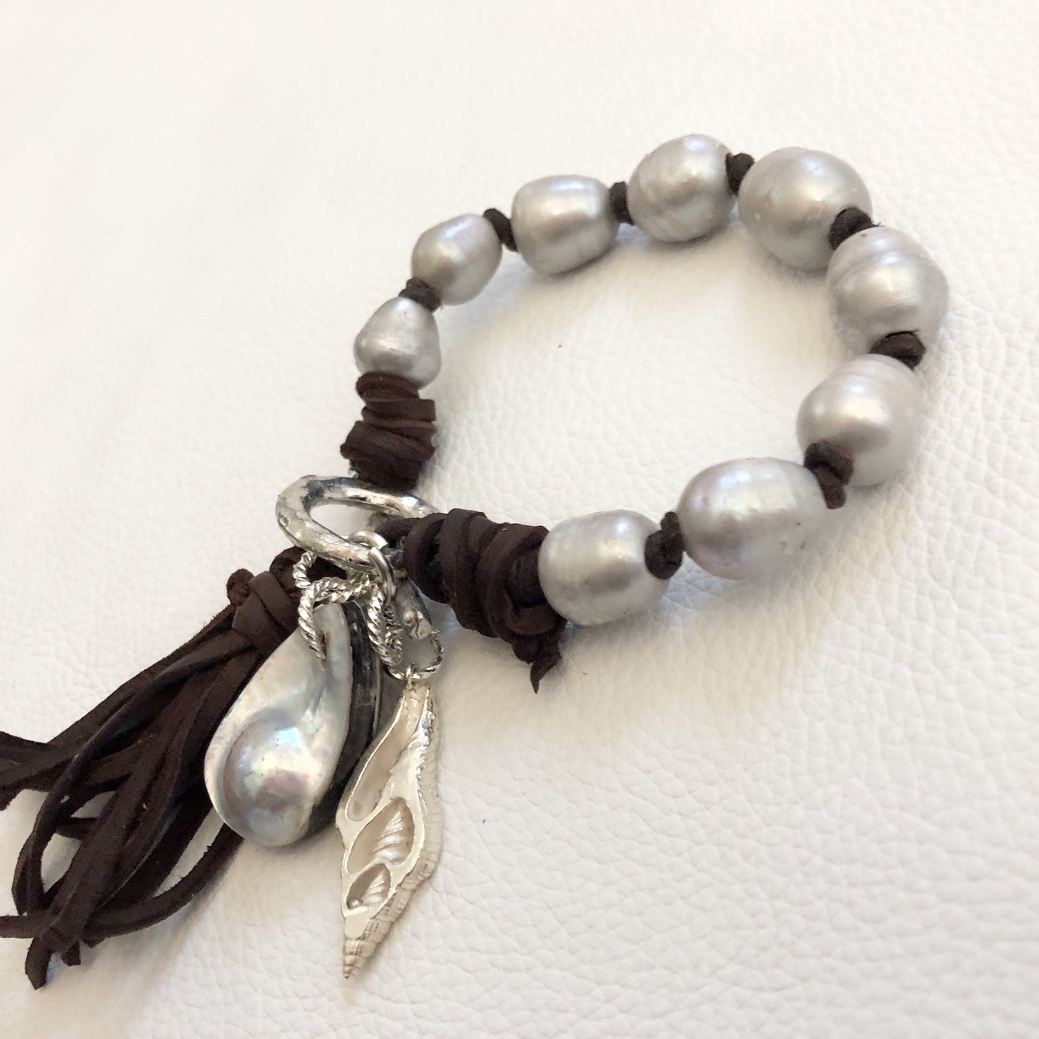 freshwater pearl bracelet charm bracelet with stunning mabe pearl sterling silver shell and deerskin tassel