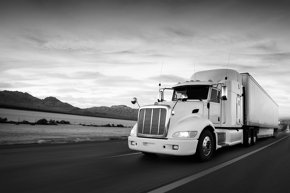 Truck-and-highway-at-sunset-BW.png