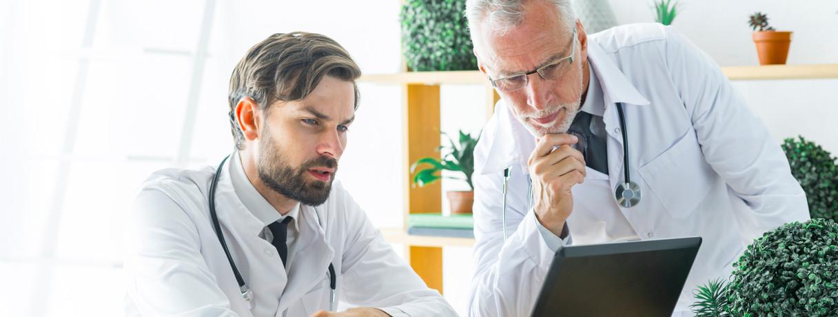 serious-doctors-looking-laptop-screen.jpg