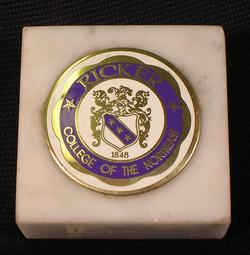 Ricker College paperweight
