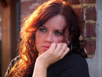 portrait-young-woman-sunlit-hair-sad-exp