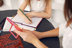 tutor-with-litthe-girl-studying-at-home-