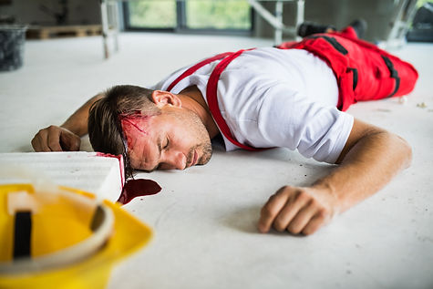 an-unconscious-man-worker-lying-on-the-f