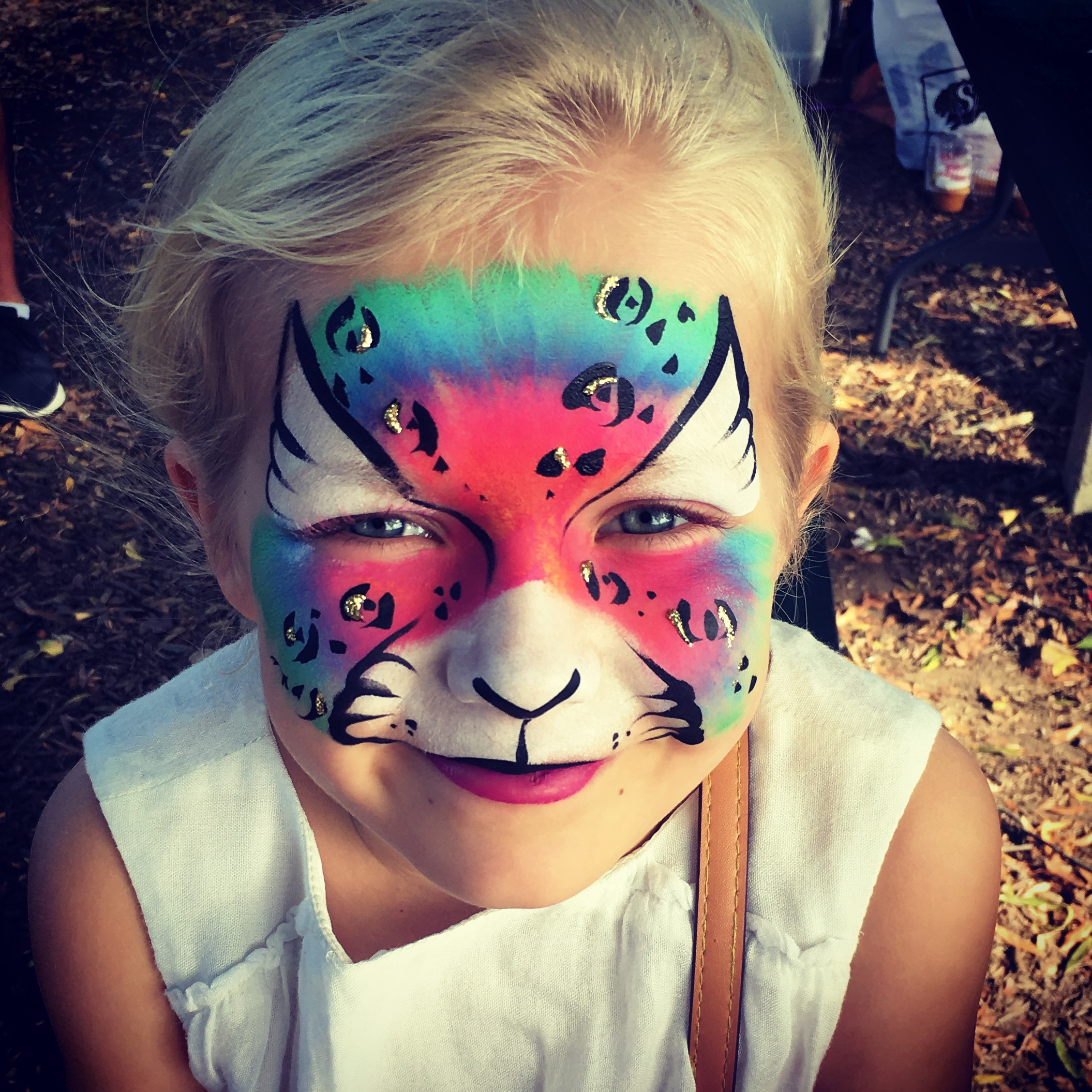 Neon Cheetah Face Painting