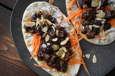 Toasted Almond and Cumin-Orange Lamb on Warm Flatbread