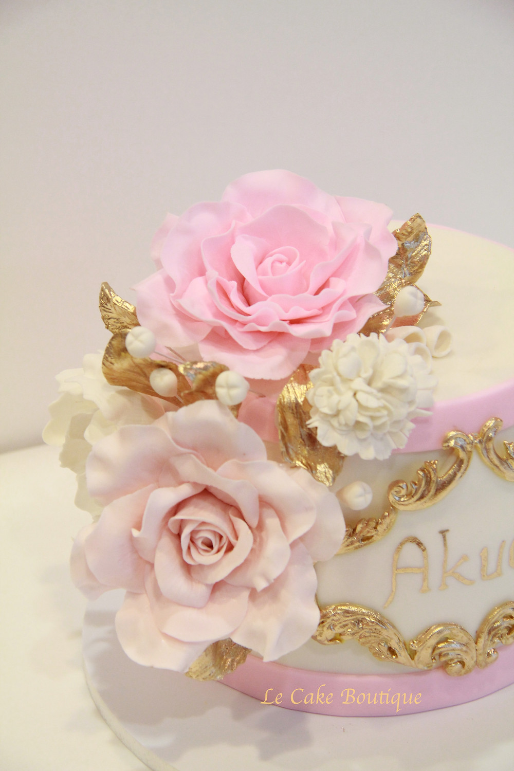 pink and gold flowers wedding cake