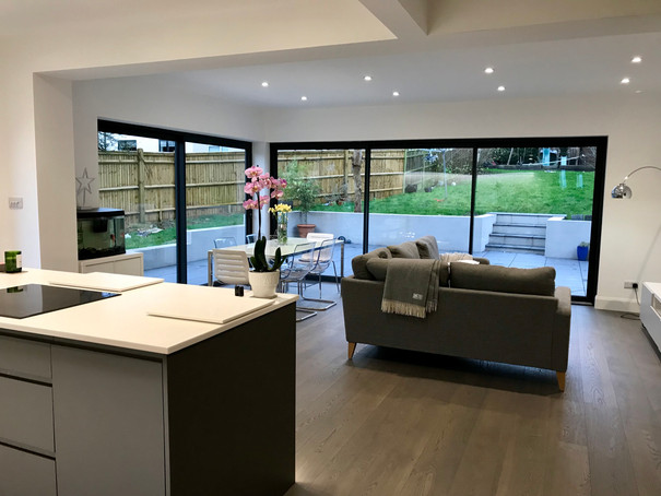 Open plan kitchen with aluminium sliding doors