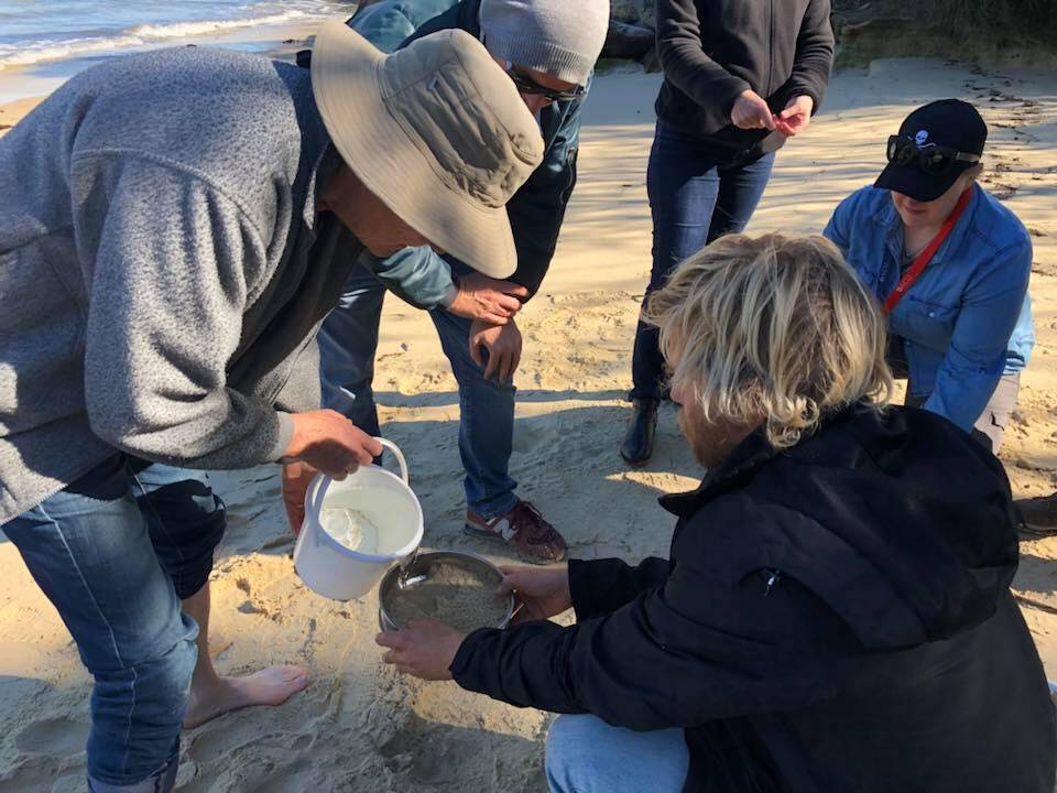 Washing the sand through to sieve to isolate the microplastics