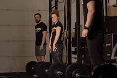 Lady smiling lifting weights.jpg