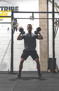 Personal Trainer lifting weights