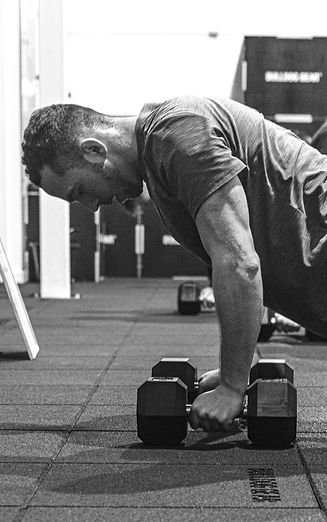 Personal Trainer on Dumbbells
