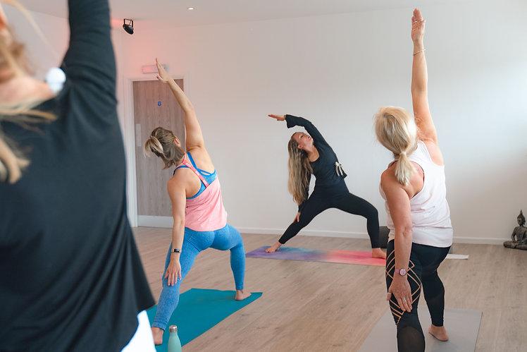 Lady teaching yoga class.jpg