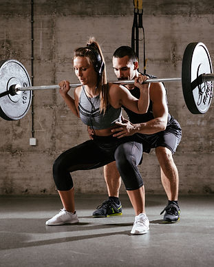Young woman doing squat exercise at the