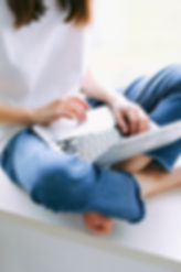 person-in-blue-denim-jeans-using-macbook