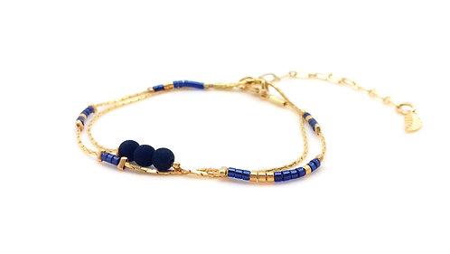Bracelet double tour doré et bleu.