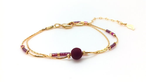 Bracelet double tour doré prune.