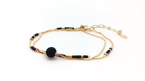 Bracelet double tour doré et noir.