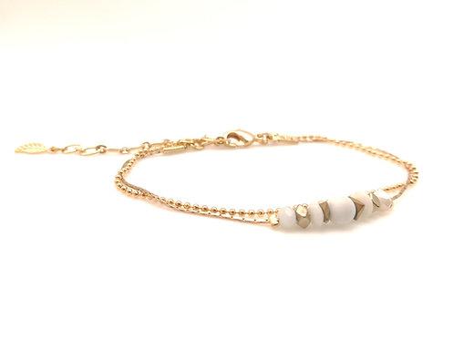 Bracelet double doré et blanc.