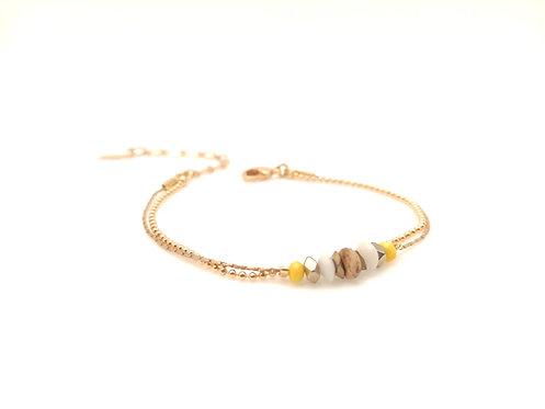 Bracelet double doré et jaune.