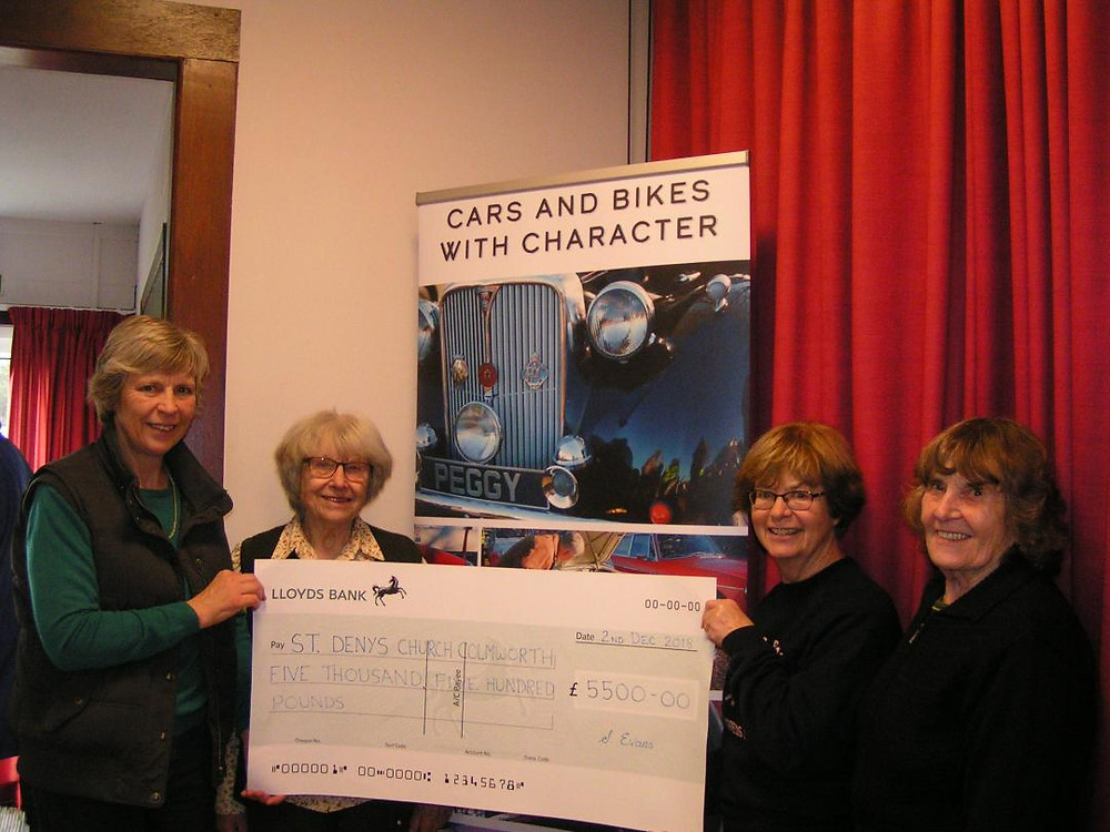 Churchwardens Kate Abrahams, Thelma Marks, Heather Smith and Betty Johnson receive the cheque from The Friends' of St Denys