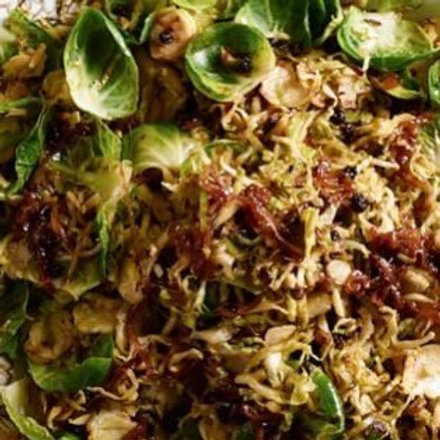 Shaved Brussels with shallots and currants