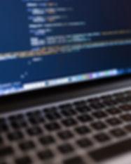 Code on Laptop Computer