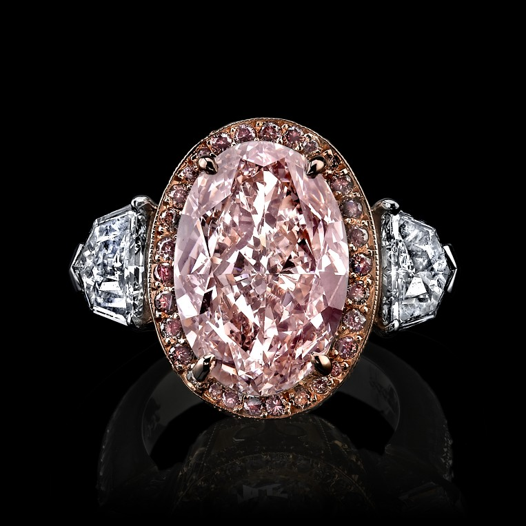 Rare Pink Diamond 3 stone with halo