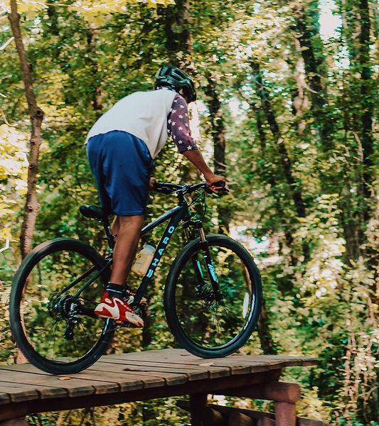 Student Riding Mountain Bike