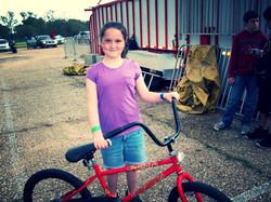 a little girl enjoying her bike