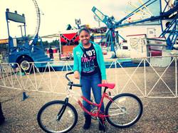 a little girl enjoying her new bike