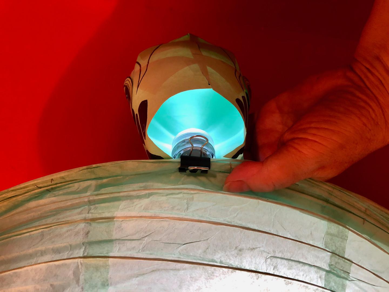 Clip the head light to the lantern.