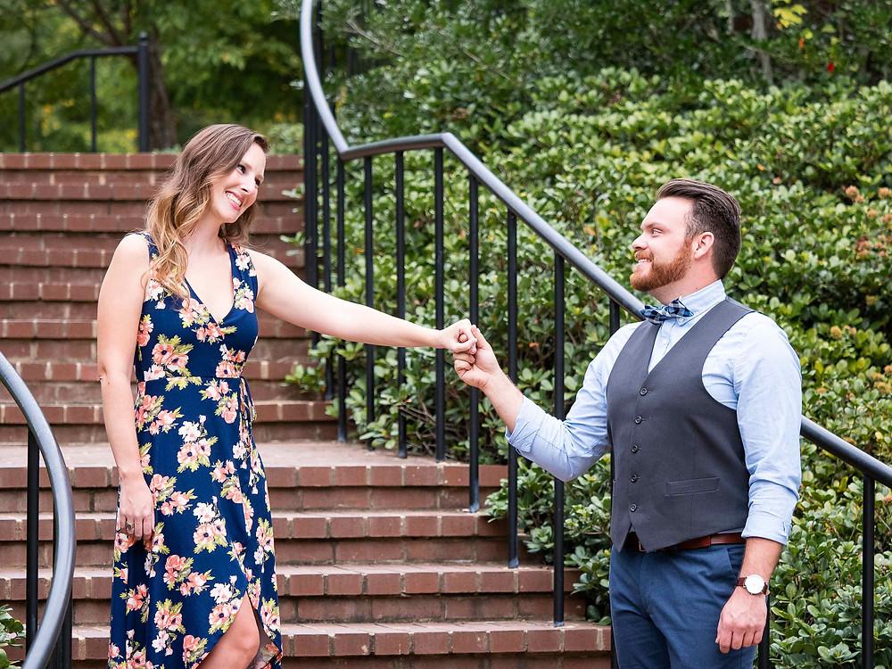 Engaged couple on brick stairway at Glencairn Garden by Sharon Elisabeth Photographyen