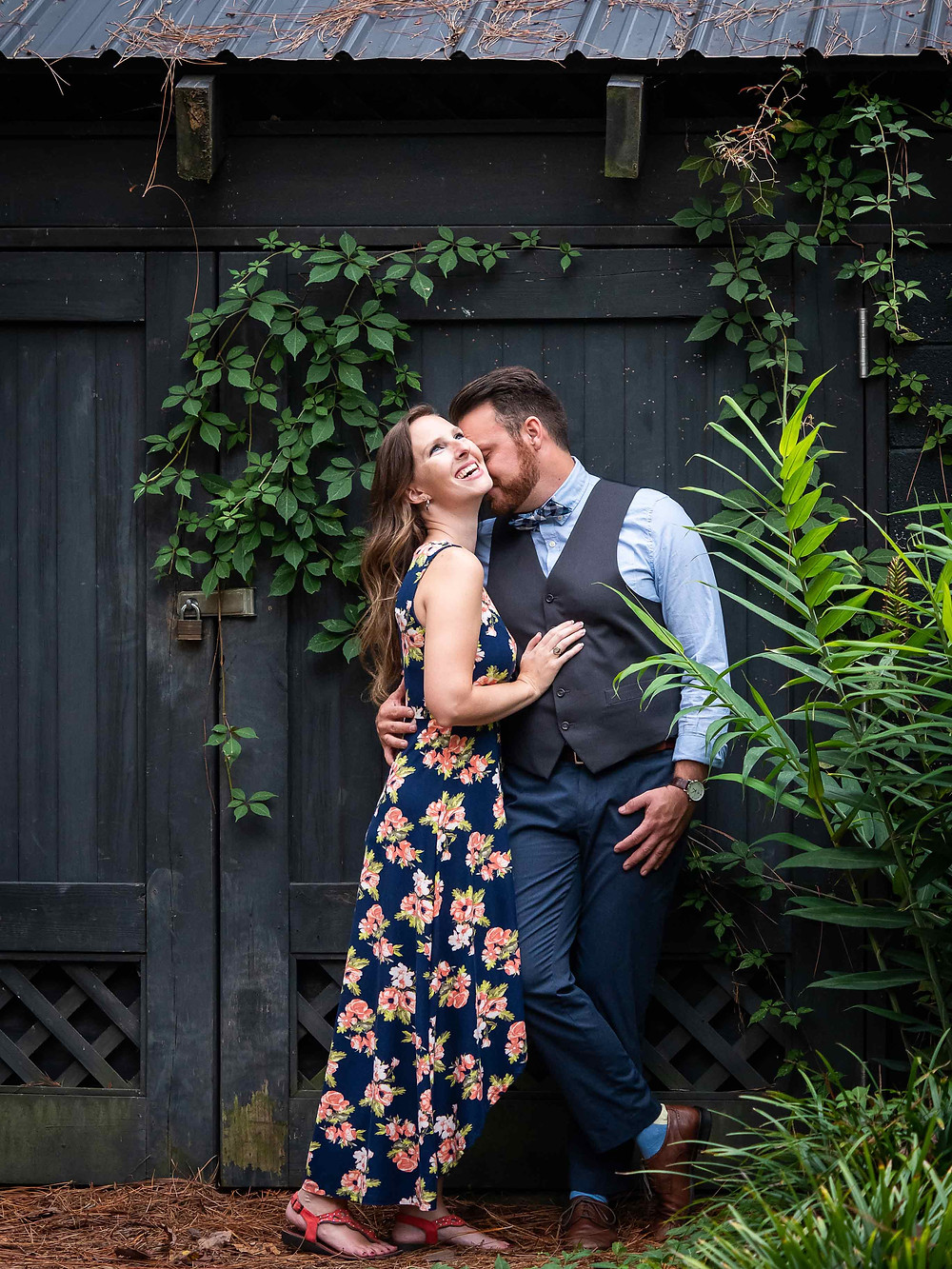 Engagement Photo in front of unique shed at Glencairn Garden by Sharon Elisabeth Photography