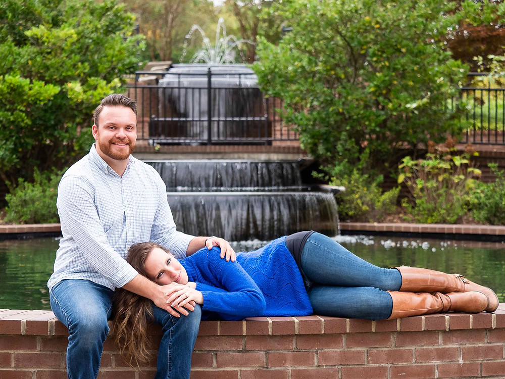 Engagement photo at Water Fountain at Glencairn Garden by Sharon Elisabeth Photography