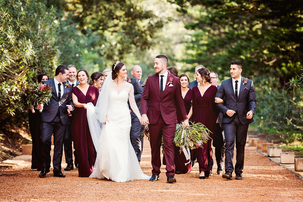​ ​​  ​manly wedding, bride and groom, cardinal cerruti chapel, wedding dress, bridal party, marsala