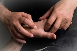 Acupressure to adult hand