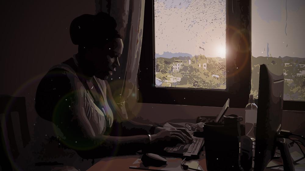 Alana in Sudan sitting by a window