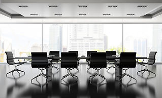 Interior of boardroom with black armchai