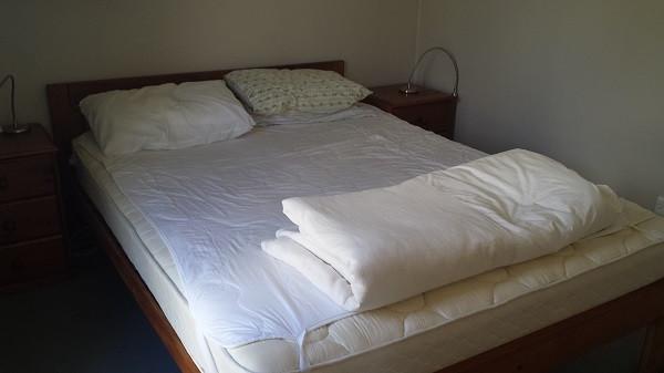 Sleepout Queen bed.jpg