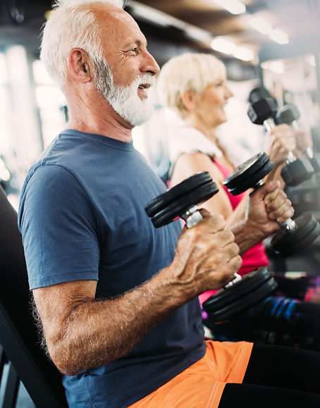 Fit senior sporty couple working out tog