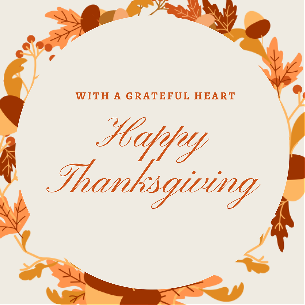 Fall leaves in a circle and With a grateful heart Happy Thanksgiving in the center