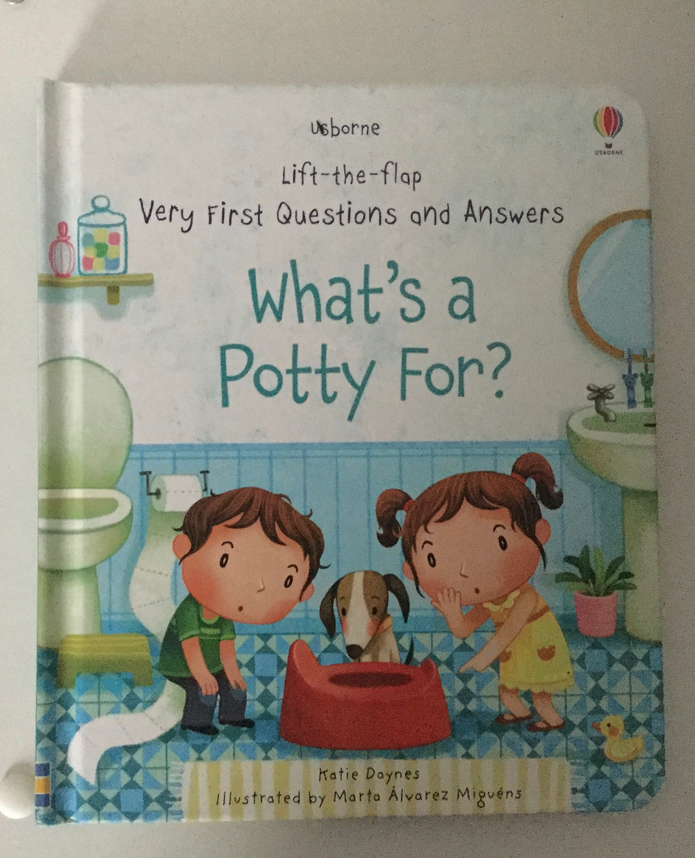 Usborne Book What's a Potty For?  Two kids on the front with their dog looking at a potty