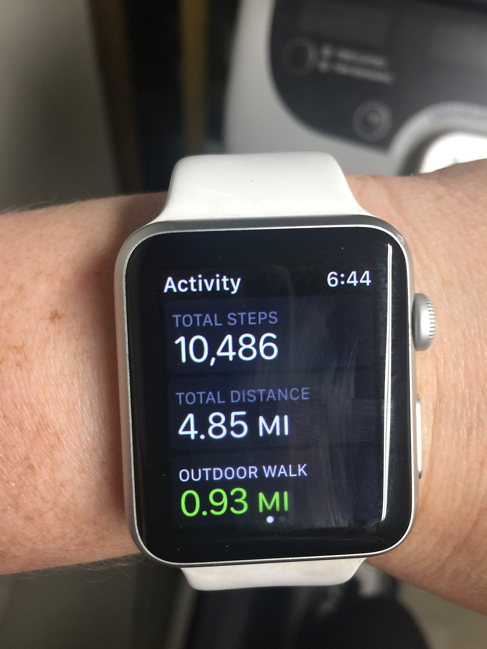 Picture of Apple Watch with image of daily step activity of 10,486 steps